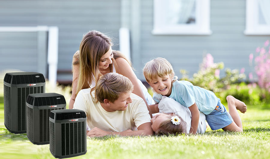 Family Laying on Grass with Air Conditioner Units Next to Them | Air Conditioning Services: Air Conditioning Replacements, Air Conditioning Repair and More for Islip, NY and the Surrounding Areas