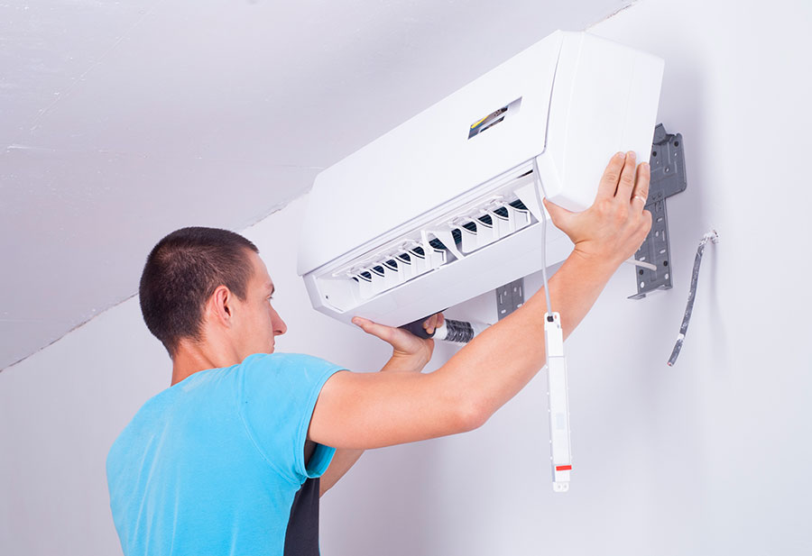Man Performing Air Conditioning Repairs, Air Conditioning Replacements & Installation for Smithtown, New York, and the Surrounding Areas